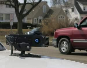 a license plate scanner on top of a police car.