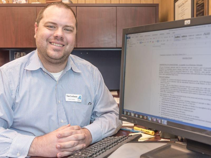 Champaign Unit 4 school district attorney Tom Lockman with a screen of some of the district's digital media policies in his office in Champaign on Wednesday, April 1, 2015.