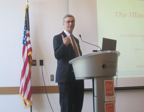 Ralph Martire of the addressed a large crowd with his fiscal plan at a town hall meeting in Champaign Monday.