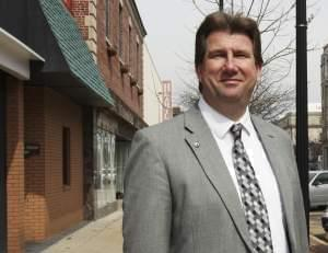 In this March 11, 2014 photo, Scott Eisenhauer, the mayor of Danville, poses for a photo in the downtown area