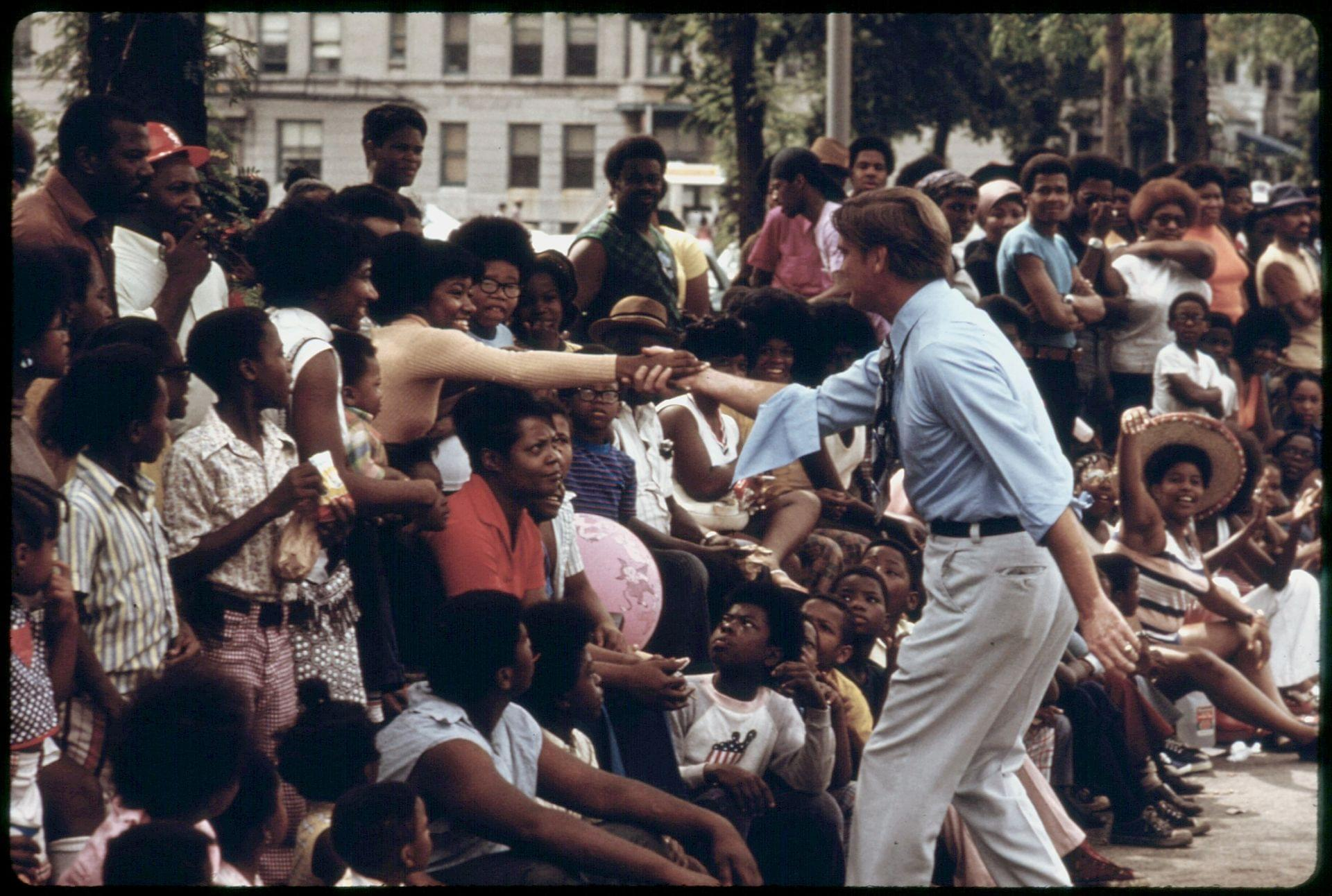 Dan Walker greets Chicago constituents during the Bud Billiken Day Parade, 1973. Photo by John H. White