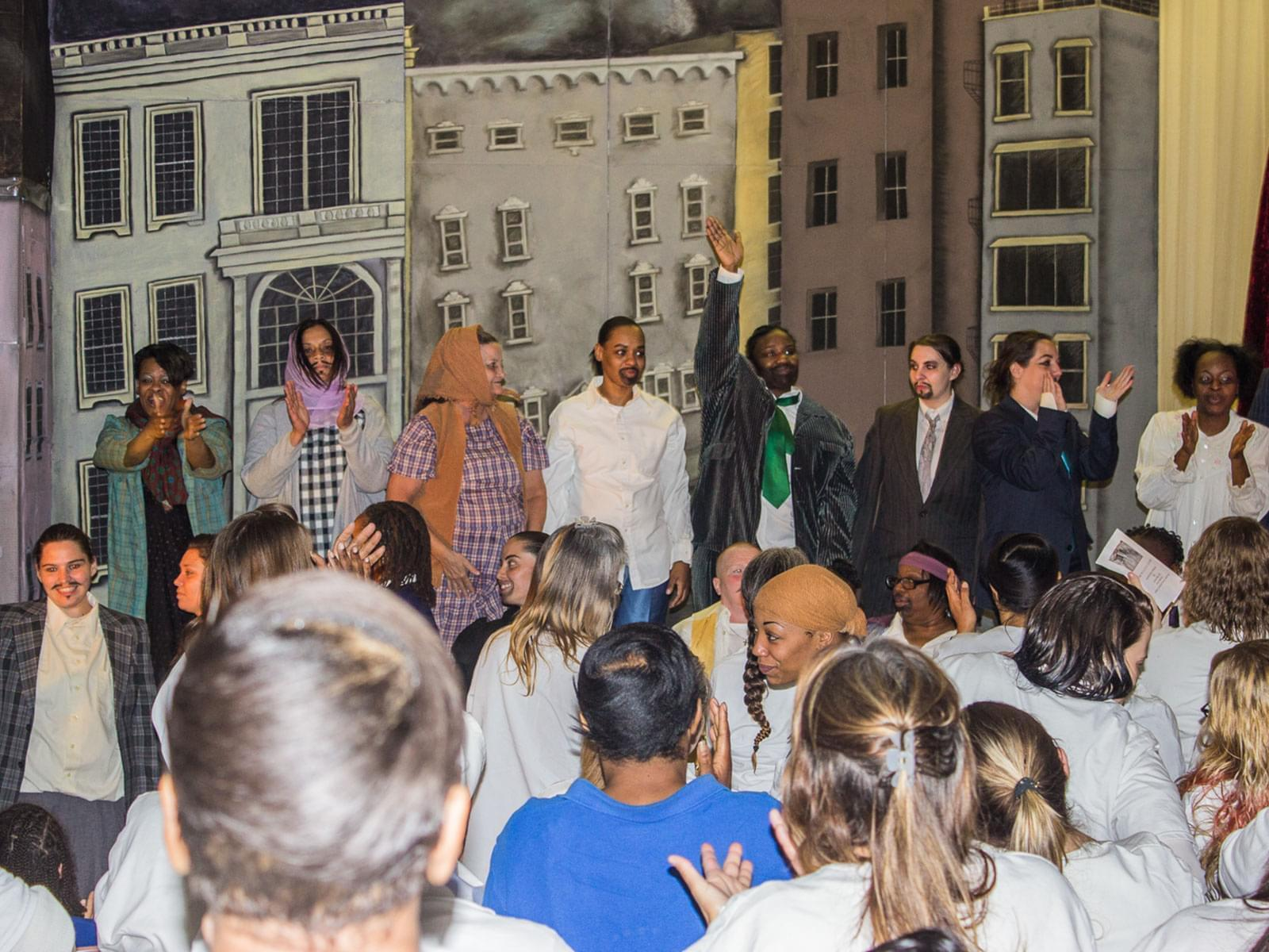 Inmates at the Decatur Correctional Center give a standing ovation to the cast of Macbeth on opening night, Wednesday, April 22