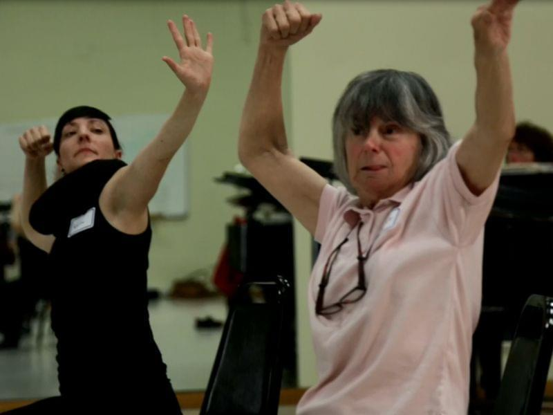 A dancer from the Mark Morris Dance Group demonstrates poses at a Dance for People With Parkinson's class.