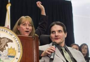 In this 2013 photo, Jim Champion, an Army veterans who has suffered from multiple sclerosis, discusses medical marijuana with wife Sandy in Chicago.