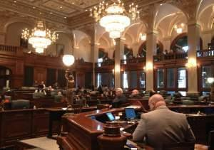 The full Illinois House listens to testimony of business groups and injured employees at the state capitol Tuesday in Springfield.