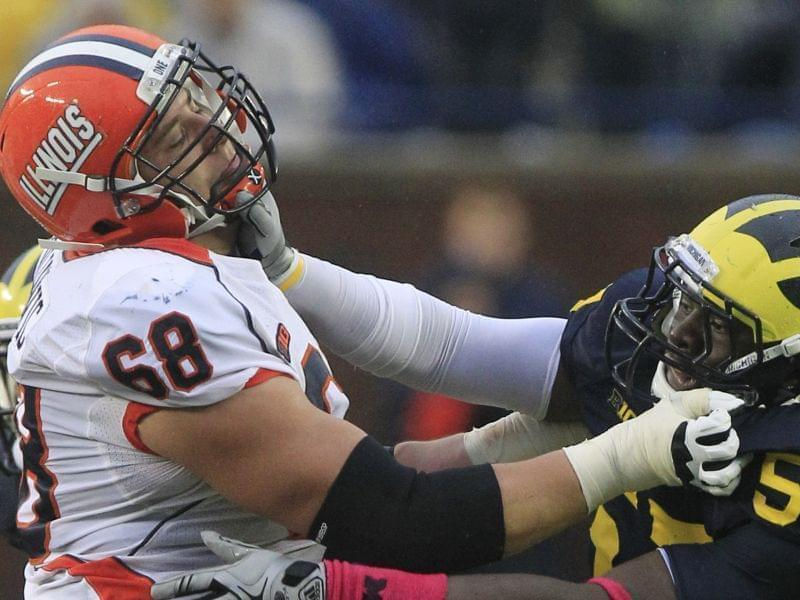 Simon Cvijanovic playing for Illinois in 2012, going up against Frank Clark of Michigan.