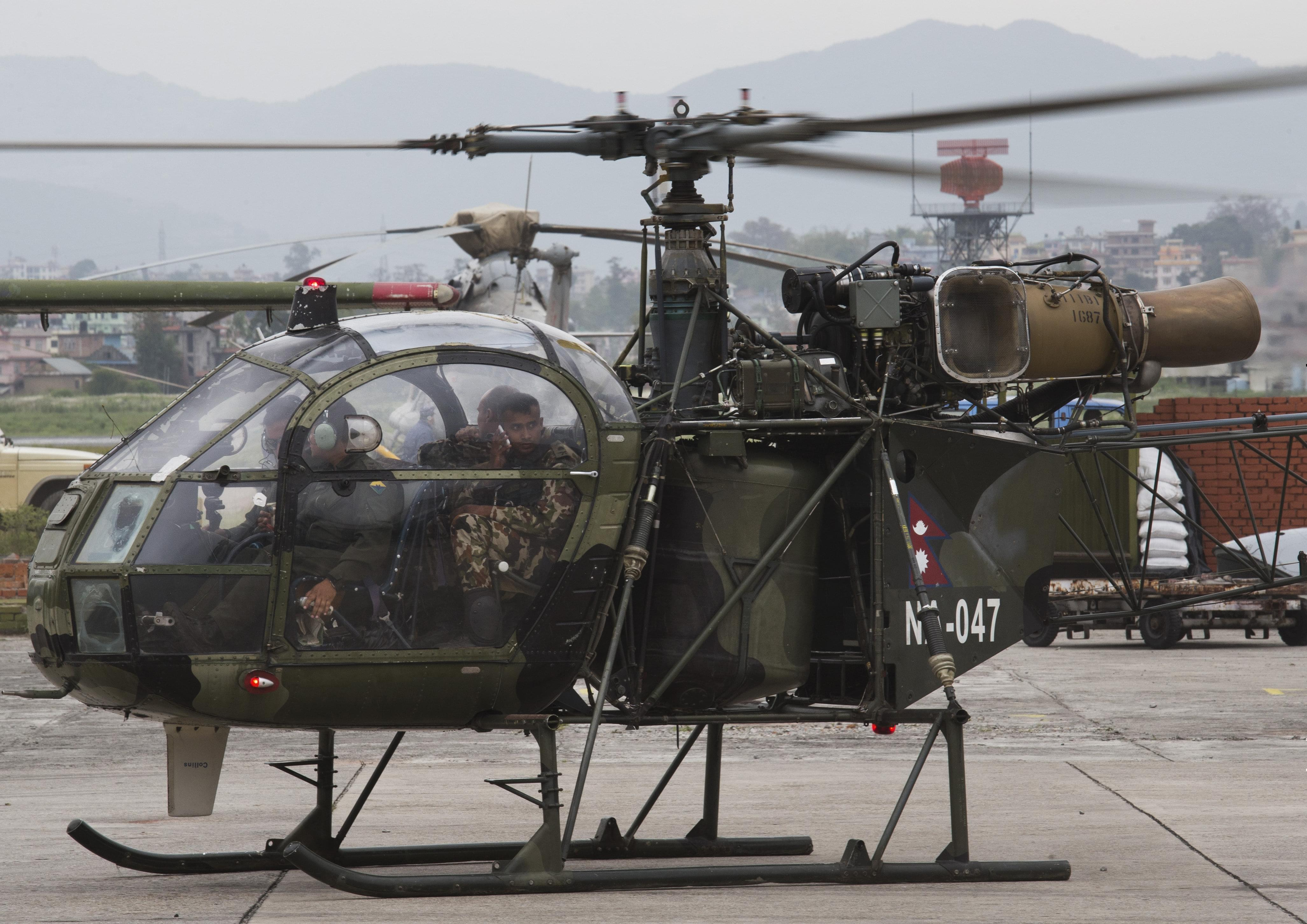 A Napalese army chopper, that spotted the suspected wreckage of the US Marine helicopter, lands in Kathmandu.
