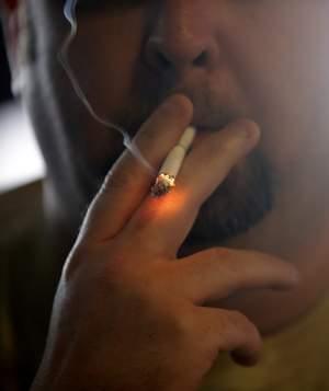 Man smoking a cigarette.