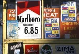 A New York convenience store displays window advertisements, including one for Marlboro cigarettes, Sunday, Dec. 11, 2005.