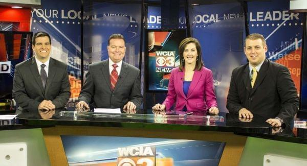 Dave Benton (2nd from left) with WCIA staff in an evening broadcast in 2014, along with sports anchor Aaron Bennett (L), anchor Jennifer Roscoe, and meterologist Derick Fabert.