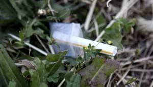 In a June 5, 2012 photo, a heroin pouch lays next to a sidewalk on Chicago's Homan Avenue.