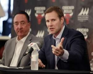 Chicago Bulls new coach Fred Hoiberg, right, speaks as general manager Gar Forman listens during an NBA basketball news conference Tuesday.