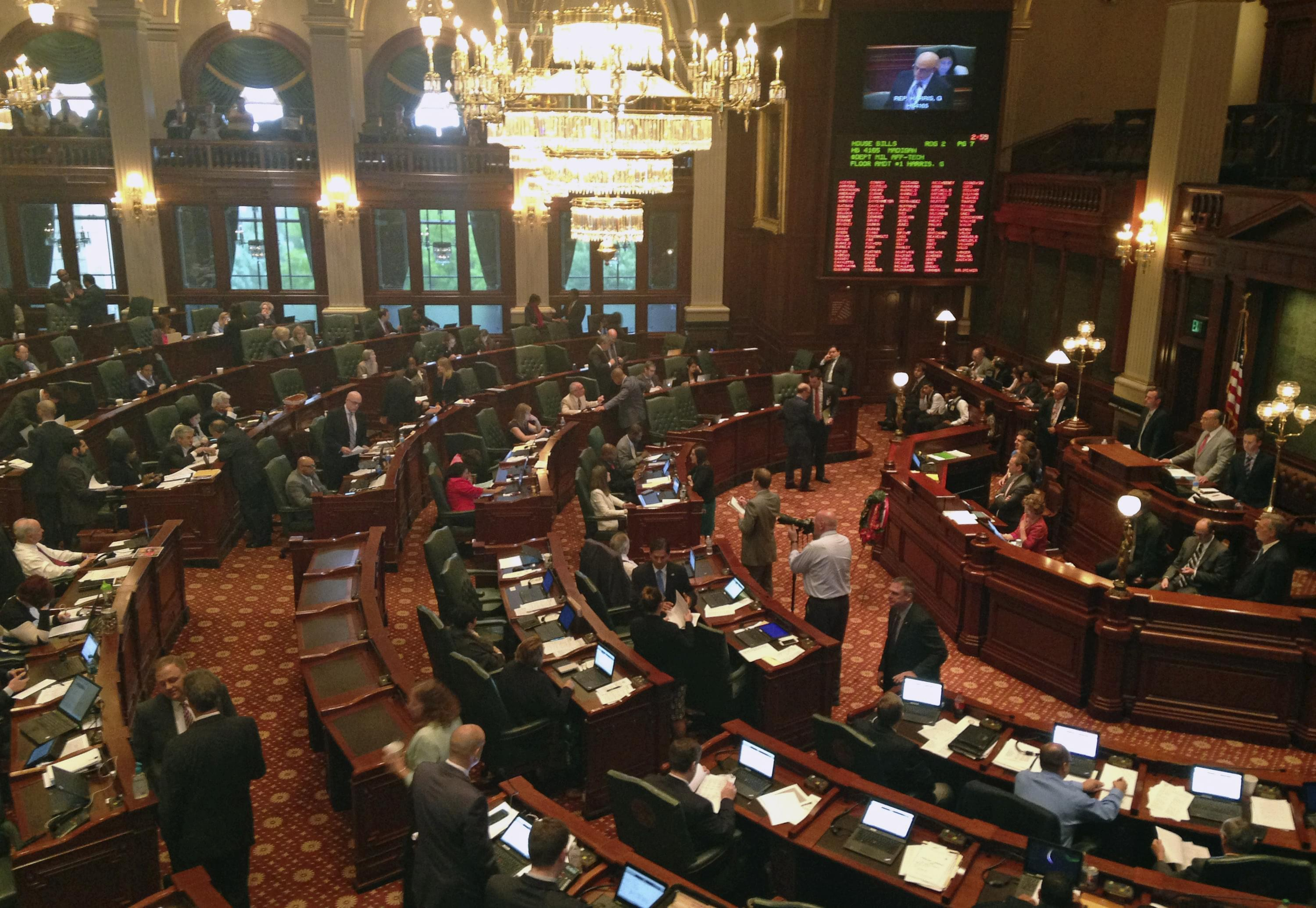 Members of the Illinois assembly meet in the House chambers, at the state Capitol. Pieces of Illinois Democrats' proposed state budget are coming into focus as lawmakers begin advancing them in the Legislature ahead of a scheduled Sunday adjourn