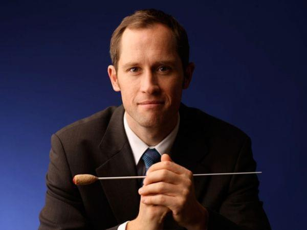 Conductor holding a baton