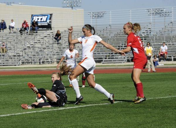 Former Illinois soccer player Casey Conine on the field