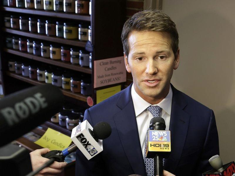 FILE - In this Feb. 6, 2015 file photo, Republican U.S. Rep. Aaron Schock speaks to reporters in Peoria, Ill., before meetings with constituents. A watchdog group has filed a complaint against Schock over his home sale to a campaign donor. According