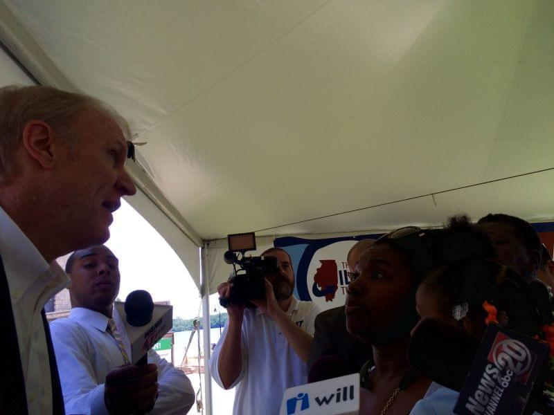 Gov. Bruce Rauner and Decatur resident Annie Yarbary chat Wednesday as media looks on.