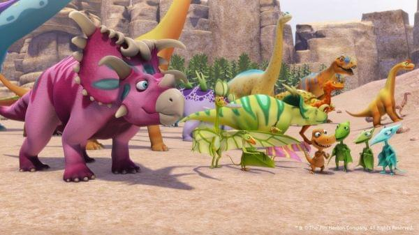 A variety of dinosaurs assemble to watch something occurring off-screen.