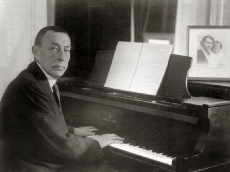 A man seated at a piano.