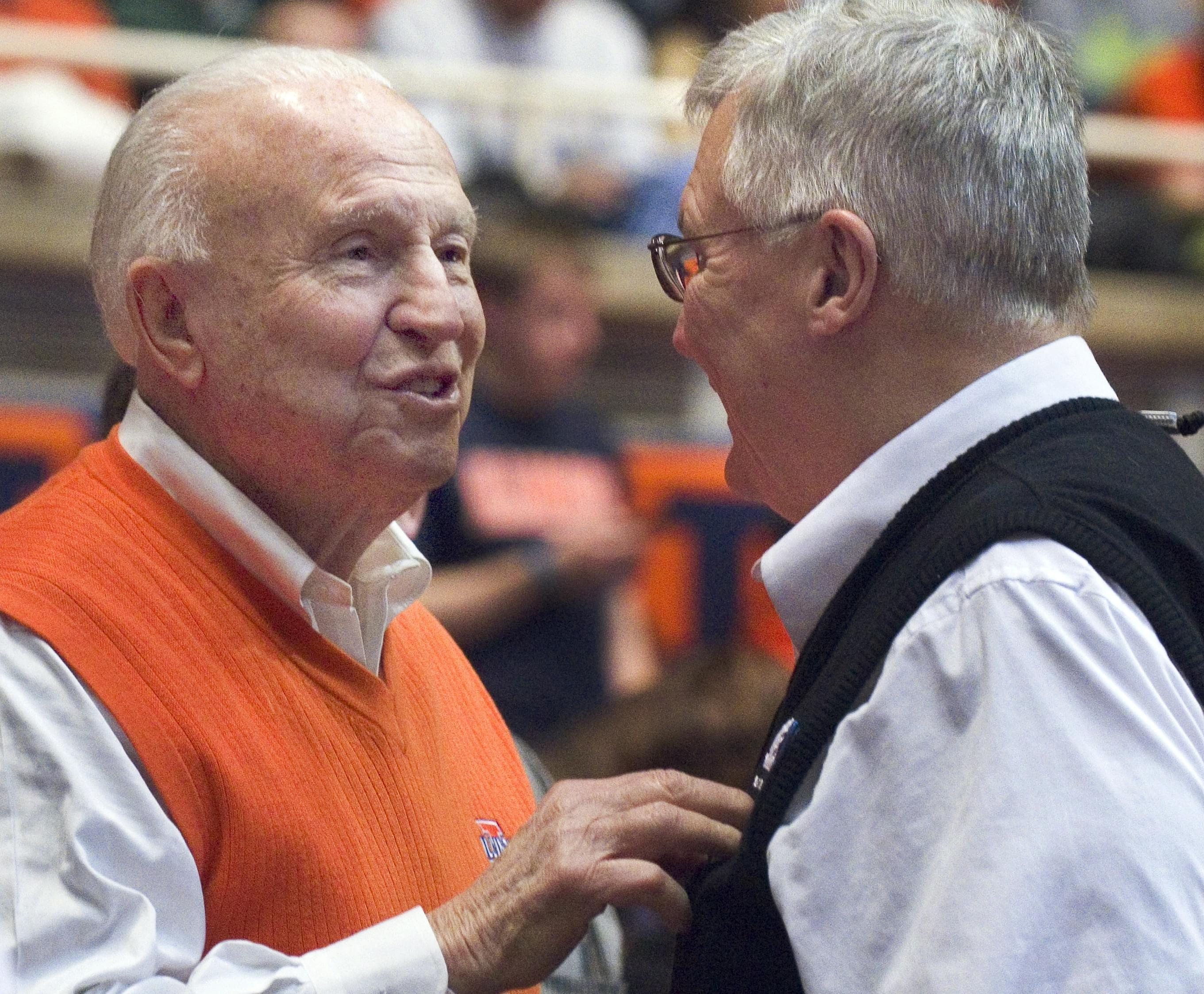 In this Jan. 18, 2014, file photo, former Illinois coach Lou Henson, left, chats with Rod Cardinal during Illinois' loss to Michigan State.