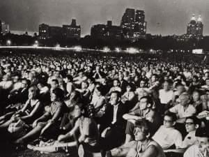 A crowd of people at an outdoor concert