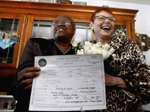 n this Nov. 27, 2013 file photo, Vernita Gray and Patricia Ewert hold their Illinois marriage license at their home in Chicago following their marriage by a Cook County judge. They were granted an exception to marry before Illinois' law formally