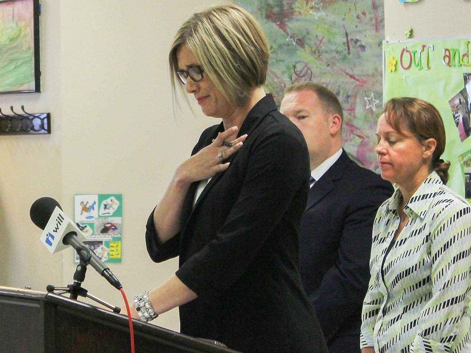 Kristina Rath, whose 11-year old son is autistic, gets emotional when addressing a group at Champaign's Developmental Services Center Monday.