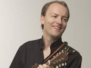 A man playing a mandolin
