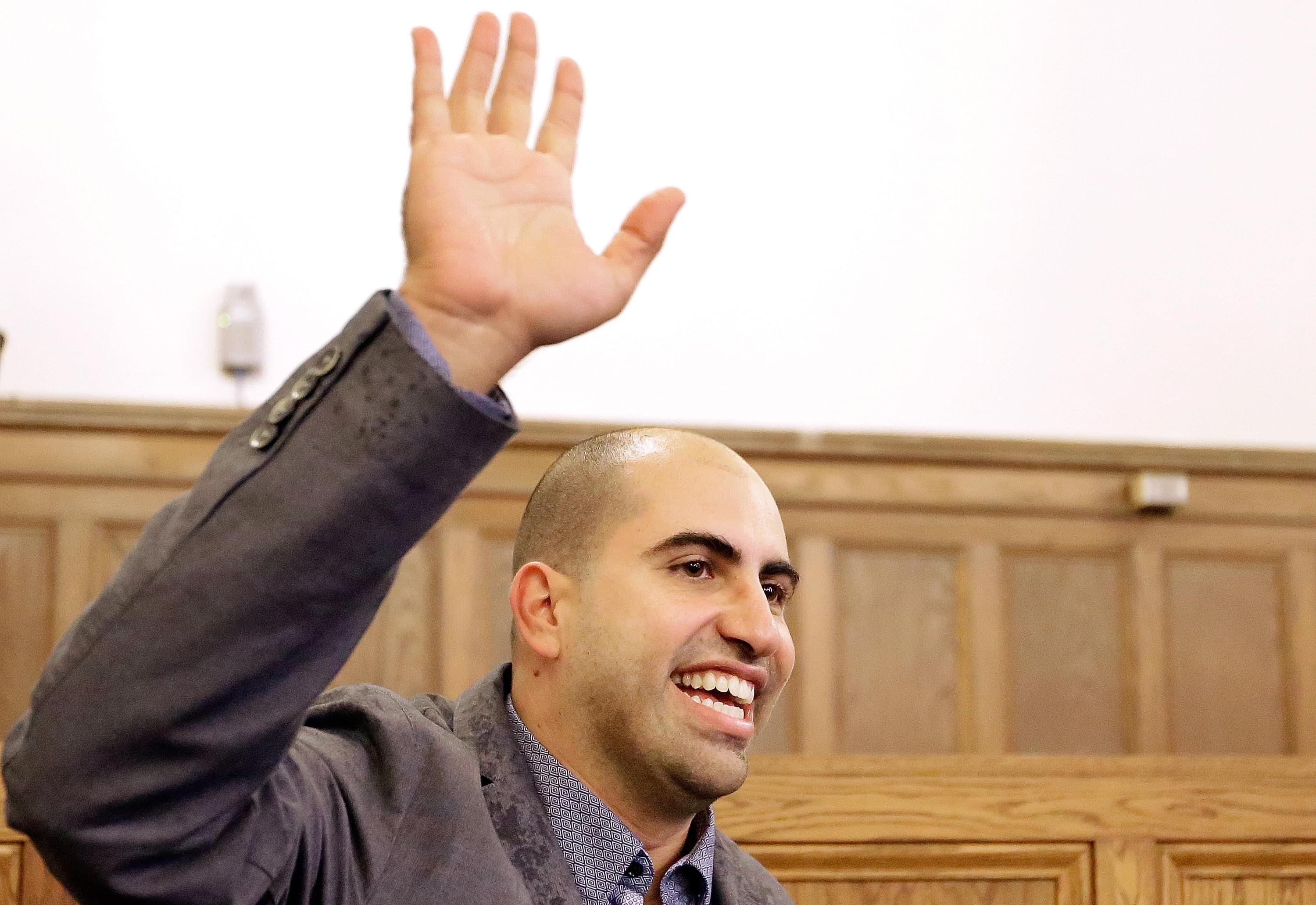 Steve Salaita, who lost a job offer from the University of Illinois over dozens of profane Twitter messages that critics deemed anti-Semitic, speaks to students and reporters during a news conference at the University of Illinois last September.