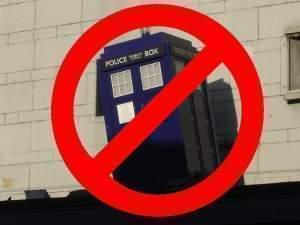"The TARDIS is covered by a red ""no"" symbol."