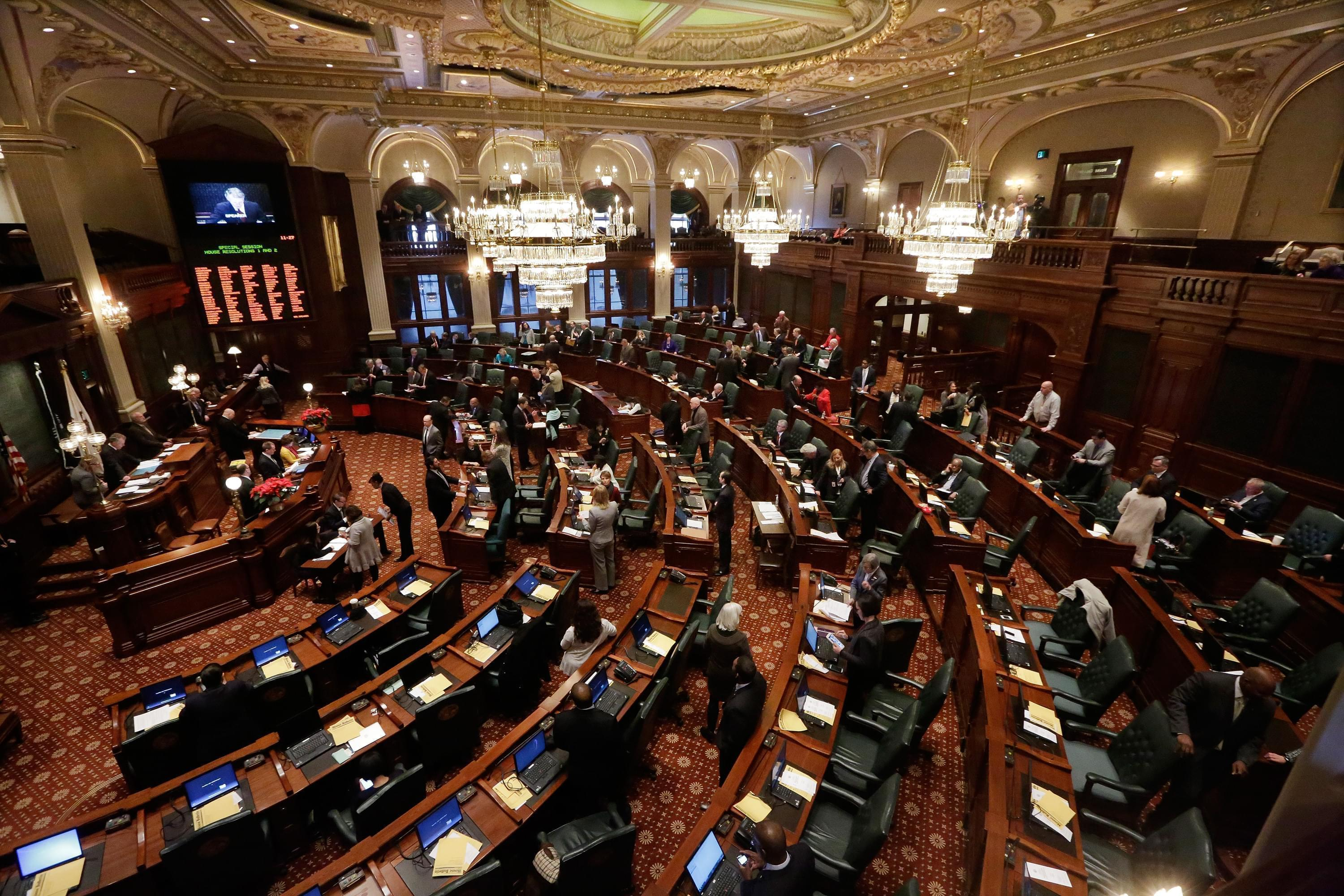 In this Jan. 9, 2015 file photo, Illinois lawmakers listen to Speaker of the House Michael Madigan in Springfield.