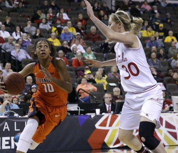 In this March 5, 2015, file photo, Illinois' Amarah Coleman drives to the basket as Nebraska's Chandler Smith guards during a game in Hoffman Estates, Ill. Coleman is one of seven former University of Illinois women's basketball player