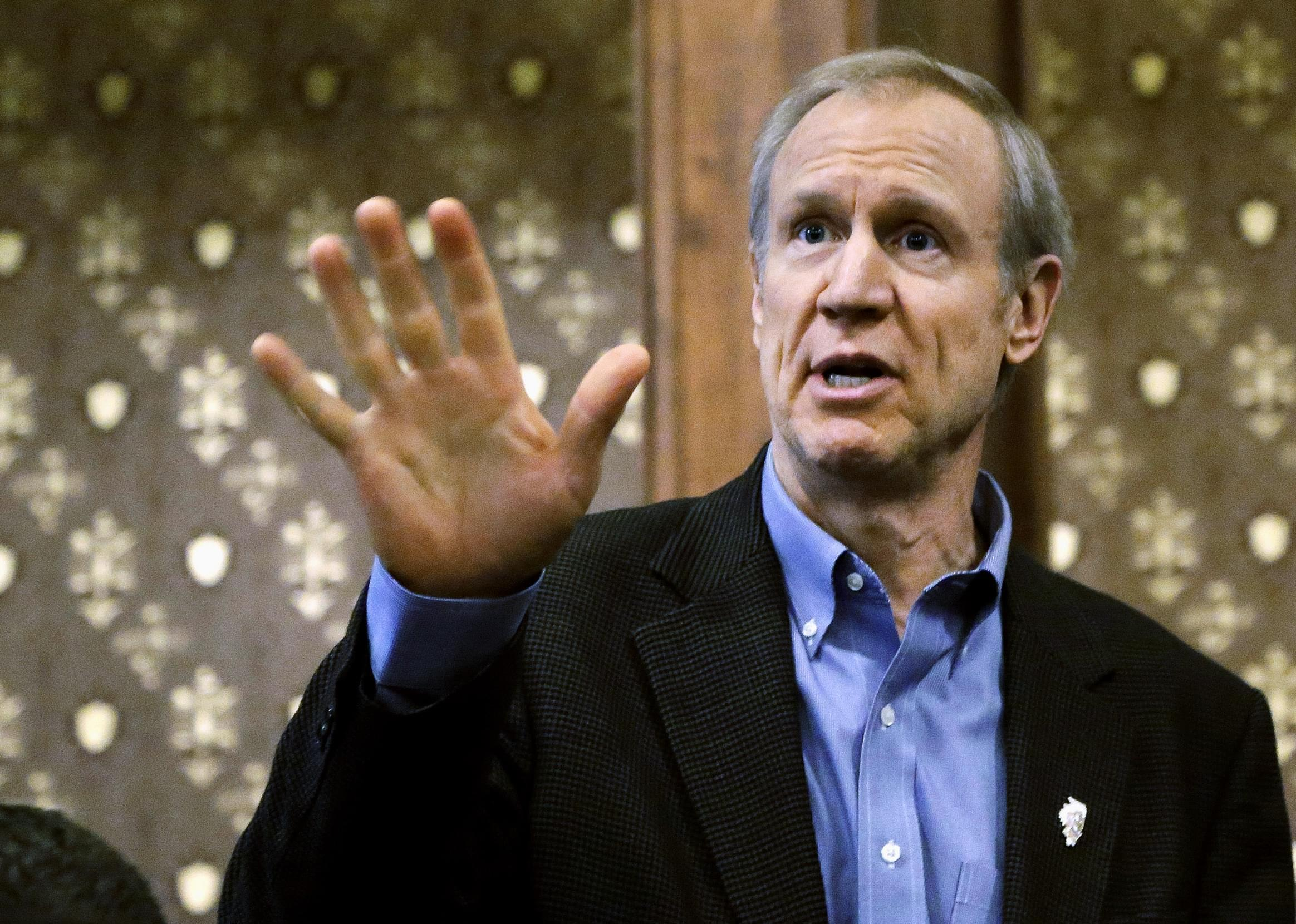 Illinois Gov. Bruce Rauner speaks to cabinet members during a meeting at the state Capitol, Feb. 25  in Springfield,