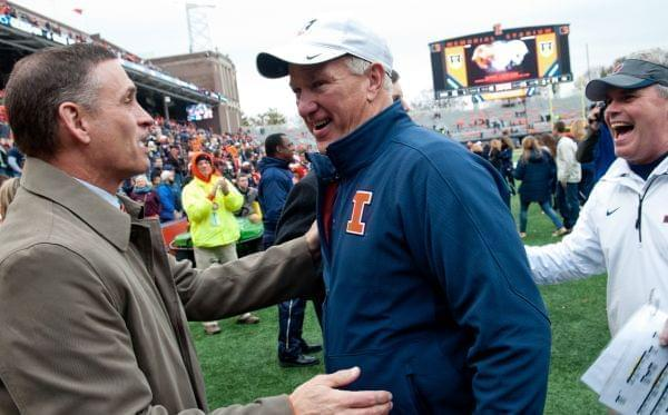 Illinois athletic director Mike Thomas greets offensive coordinator Bill Cubit and head coach Tim Beckman after beating Penn State on Nov. 22, 2014, at Memorial Stadium in Champaign.