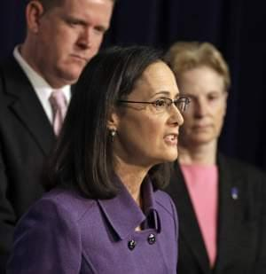 In this March 31, 2015 file photo, Illinois Attorney General Lisa Madigan speaks at a news conference in Chicago. On Tuesday, July 7, 2015, Cook County Judge Diane Joan Larsen ruled that Illinois may not continue to pay state workers in full during
