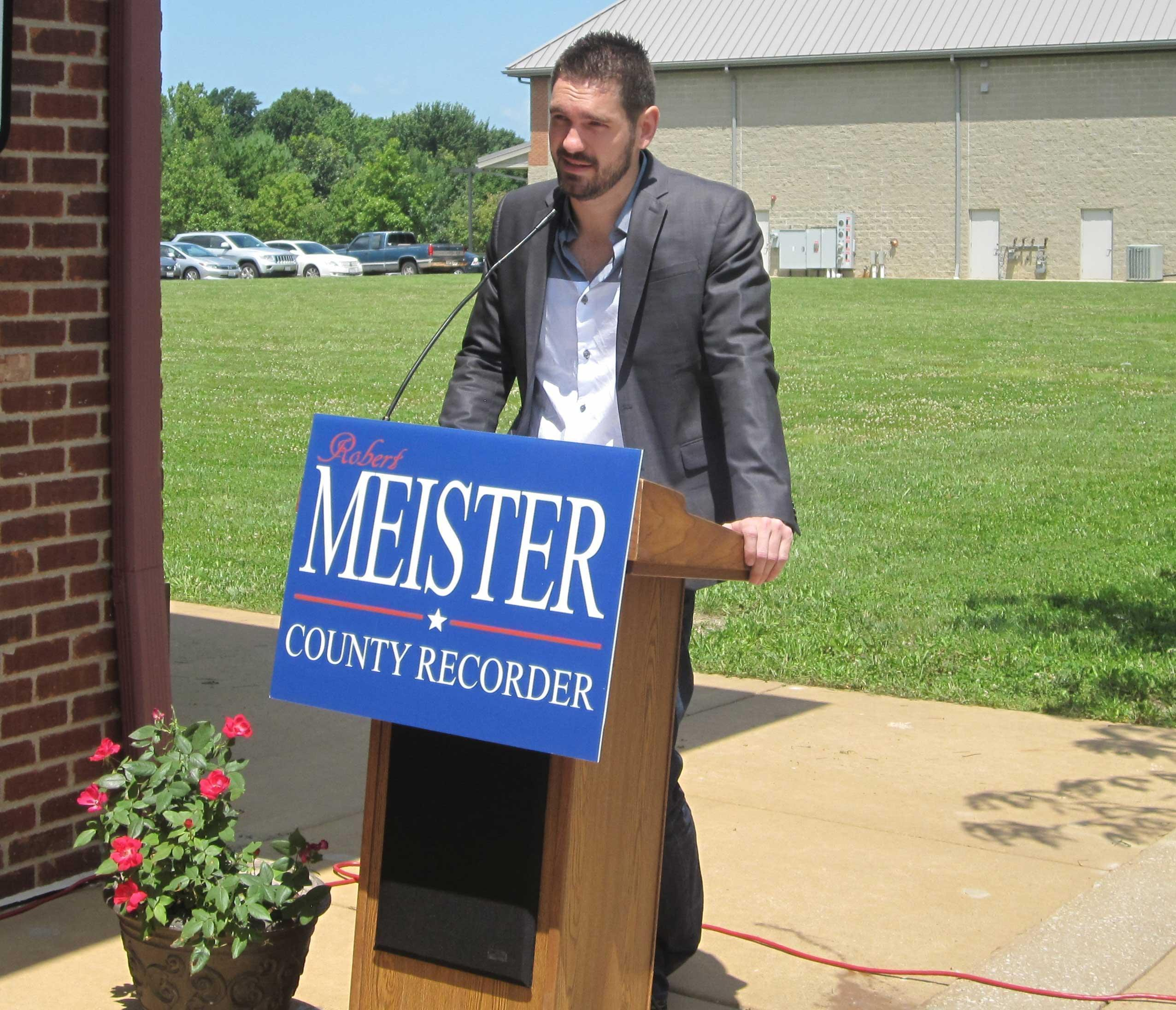 Rob Meister of Champaign announces his candidacy for county recorder outside his restaurant, Minneci's, in Champaign Tuesday.