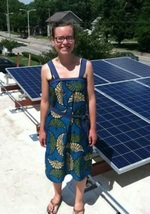 Holly Nelson on the roof with solar panels at First Mennonite Church of Champaign-Urbana