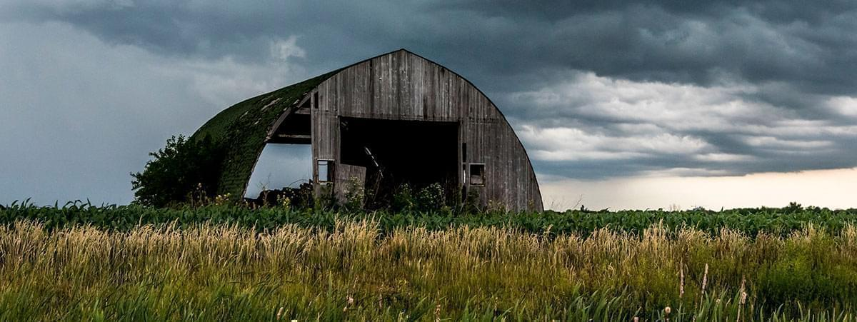 A storm hovers over an Illinois rural landscape