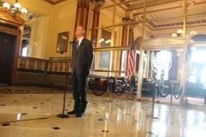 Gov. Bruce Rauner holds a press conference in early July, as Illinois began the new fiscal year without a budget.