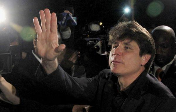 In this March 15, 2012 file photo, former Illinois Gov. Rod Blagojevich waves as he departs his Chicago home for Littleton, Colo., to begin his 14-year prison sentence on corruption charges.