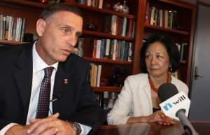 U of I Athletic Director Mike Thomas and Urbana Chancellor Phyllis Wise address reporters in her  campus office in Champaign Monday.