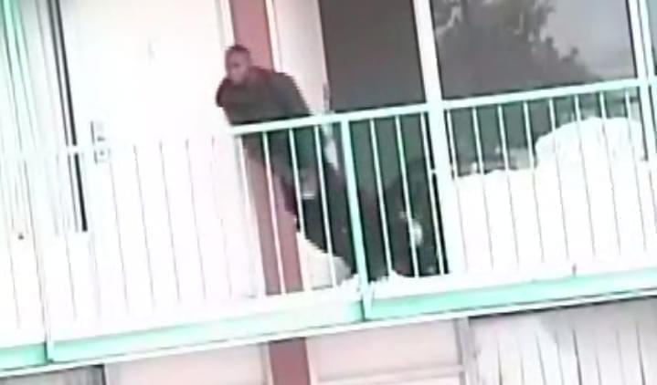 Darius Graves runs from a Rantoul motel room, in a screenshot from police video.