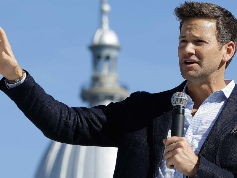 Former U.S. Rep. Aaron Schock, R-Ill., speaks in support of Republican gubernatorial candidate Bruce Rauner during a campaign rally outside the State Capitol in Springfield, Monday, Nov. 3, 2014.
