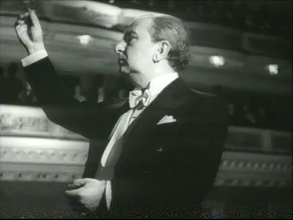 A man conducting an orchestra
