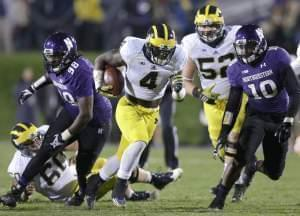 In this Nov. 8, 2014 file photo Michigan running back De'Veon Smith runs against Northwestern during a game in Evanston, IL.