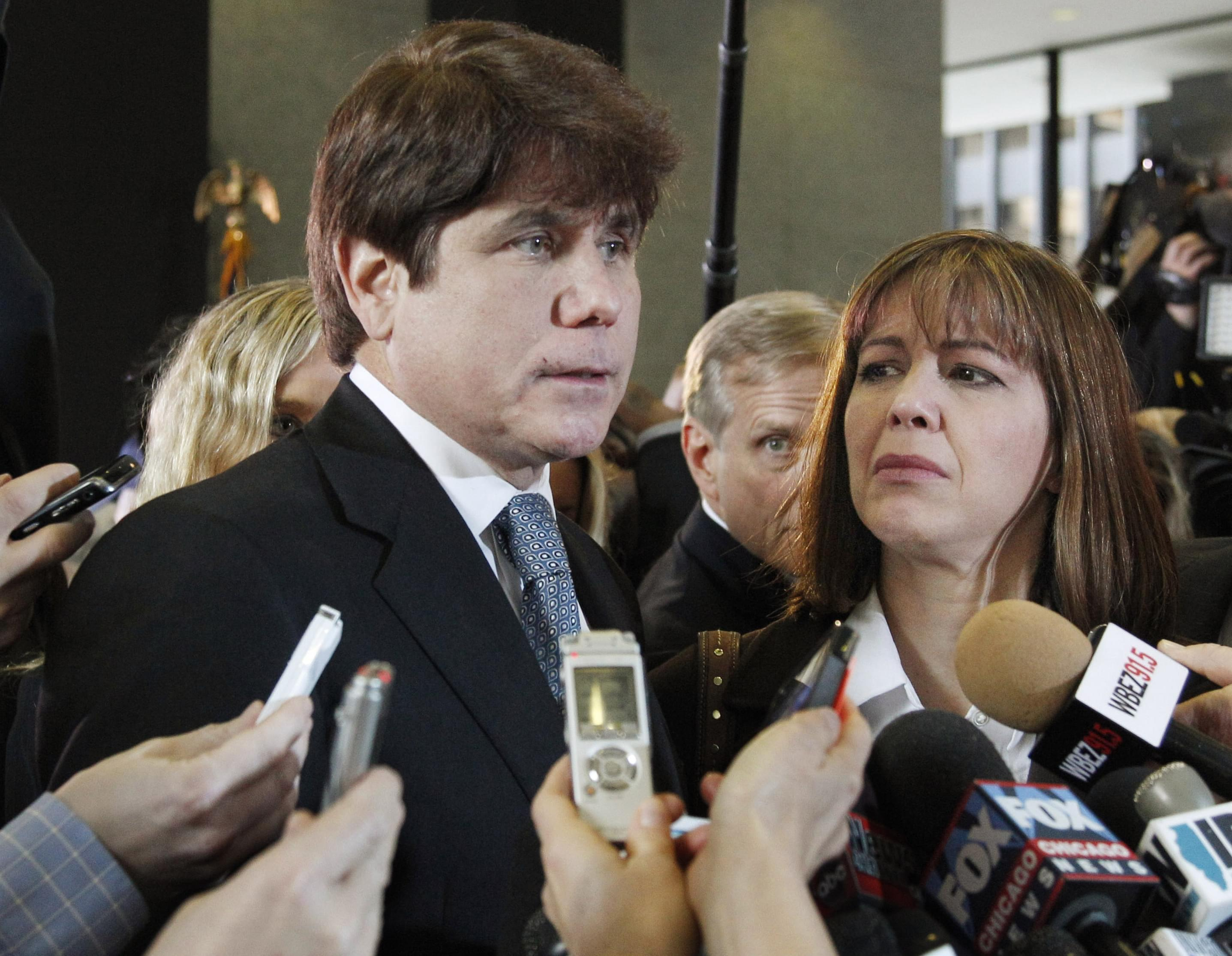 In this Dec. 7, 2011 file photo, former Illinois Gov. Rod Blagojevich, left, speaks to reporters as his wife, Patti, listens at the federal building in Chicago, after Blagojevich was sentenced to 14 years on 18 corruption counts.