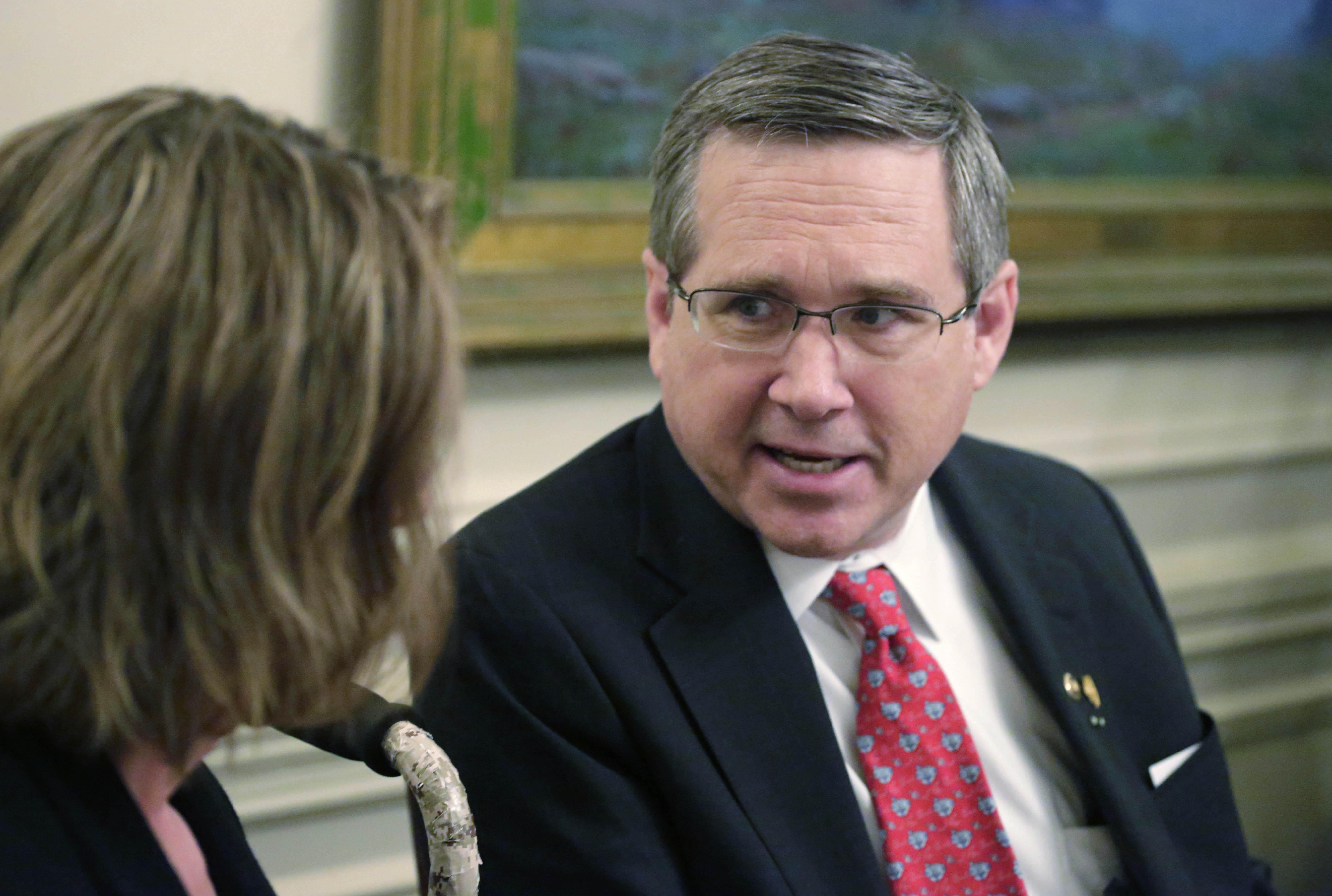 Sen. Mark Kirk, R-Ill., speaks to Illinois Republican Senate leader Christine Radogno in Chicago.