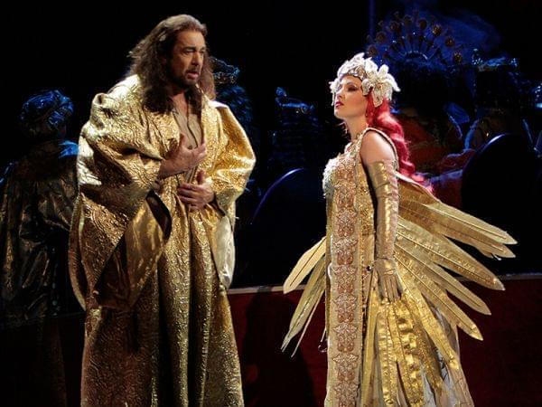 A man and a woman onstage in an opera production