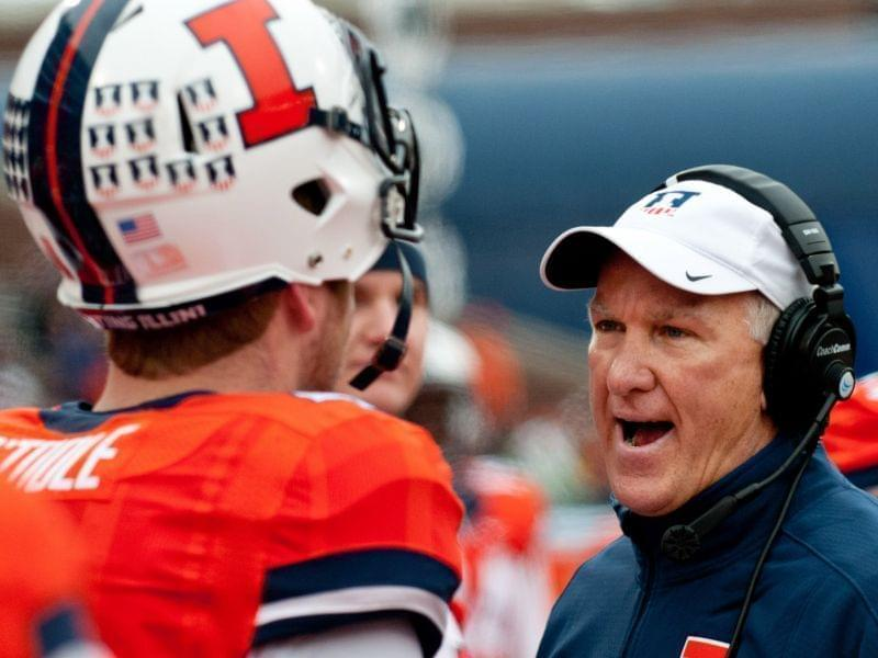 In this Nov. 22, 2014, file photo, new Illinois coach and offensive coordinator Bill Cubit talks to quarterback Reilly O'Toole (4) during a game against Penn State in Champaign,