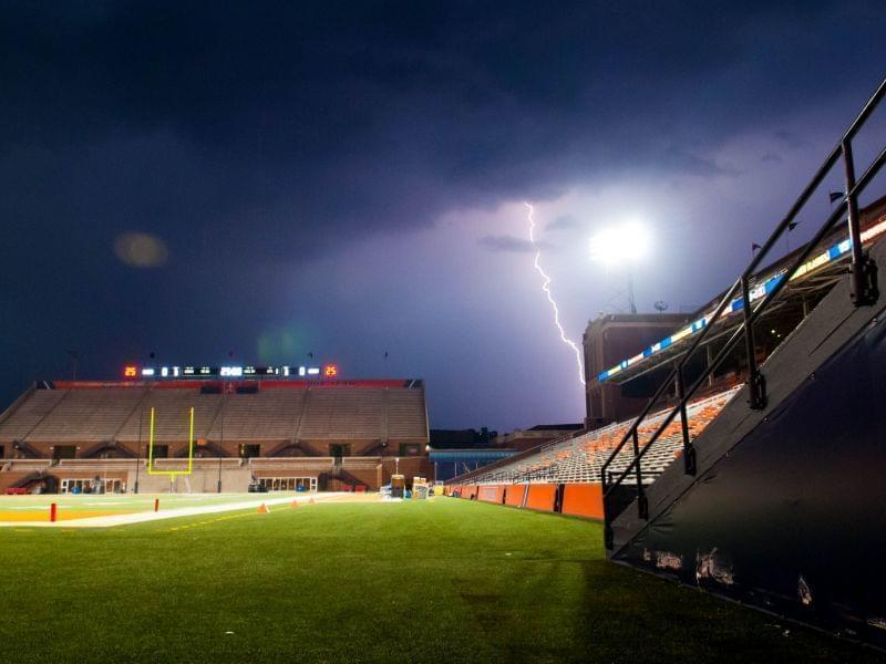 Lightning strikes in the vicinity of an empty Memorial Stadium on Friday, Sept. 4, 2015, in Champaign.